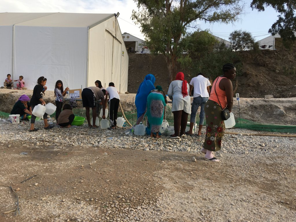 Queueing for water, Lesbos Reception and Identification Center, 7 October 2020 | Photo: InfoMigrants/M. MacGregor