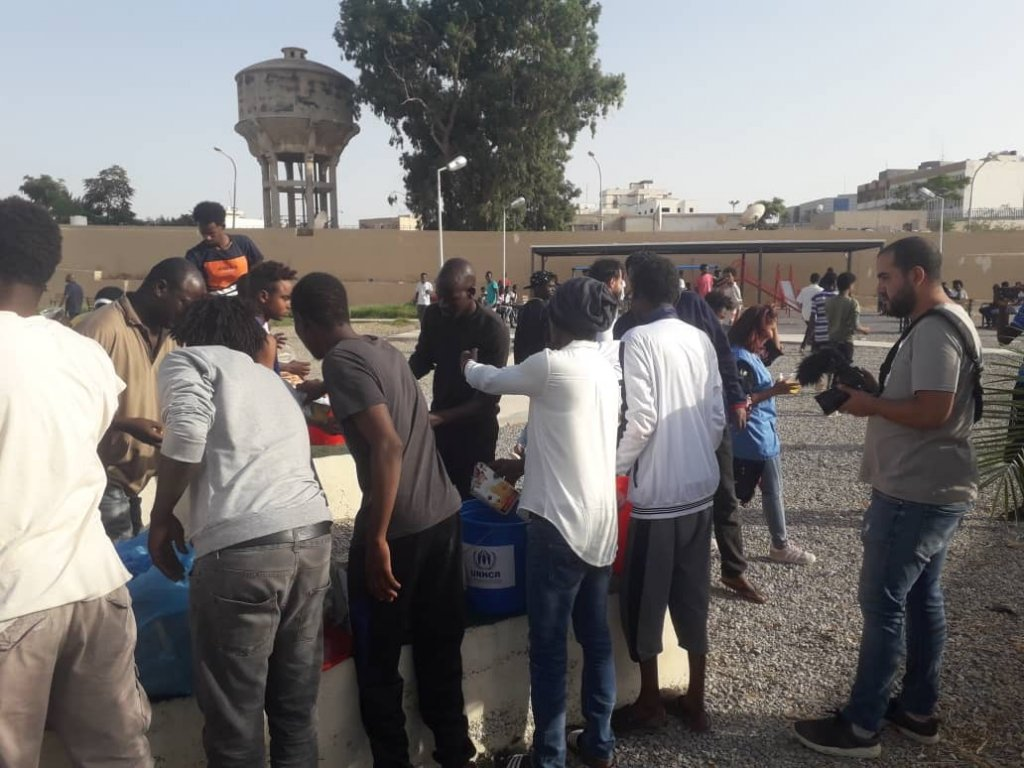 Migrants during a food distribution at the GDF in Tripoli in August 2019 | Photo: Private