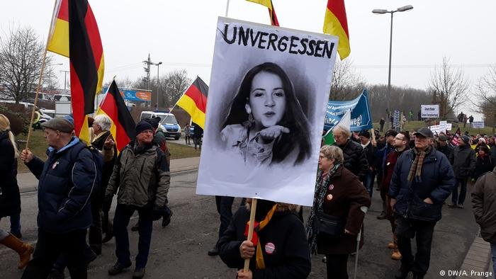 "Demonstration in Kandel. The sign showing Mia's face reads: ""unforgotten"""