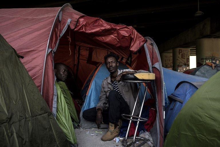 CHRISTOPHE ARCHAMBAULT / AFP |Près de 2000 migrants vont être évacués des campements et mis à l'abri (photo d'archives, 2018).