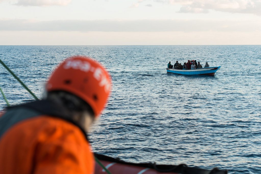 A handout photo made available by Sea-Eye shows crew members of the private rescue ship Professor Albrecht Penck watching a group of migrants in the Mediterranean Sea. Credit: EPA/ALEXANDER DRAHEIM / SEA-EYE HANDOUT
