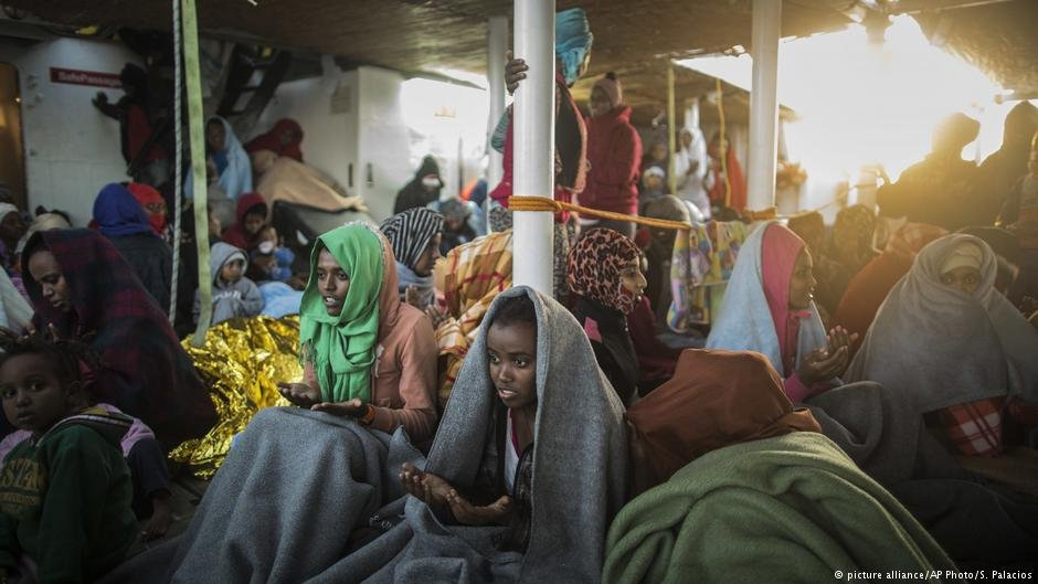 Eritrean women and children sing and pray to celebrate their arrival in Europe aboard the Spanish NGO Proactiva Open Arms rescue vessel