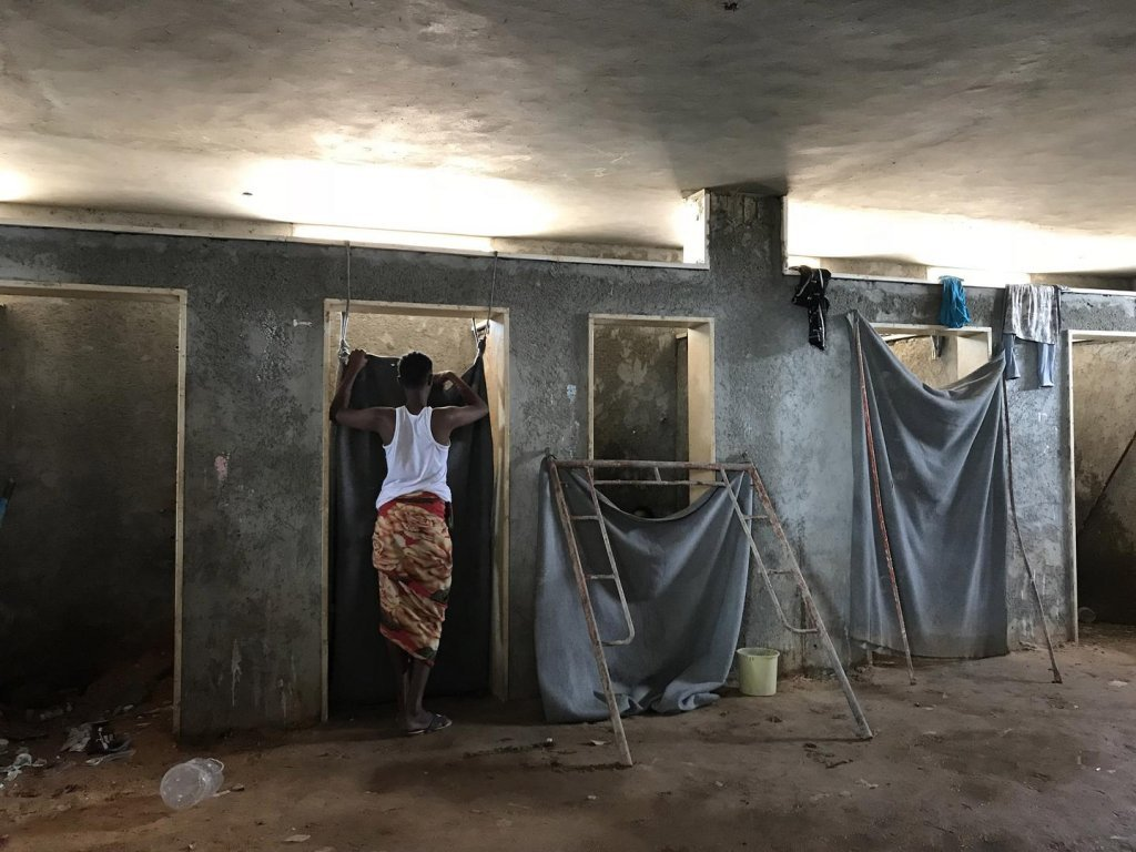 """From file: Libyan detention centers, where around 6,000 migrants are said to be held, have been described as a """"hell on earth"""" 