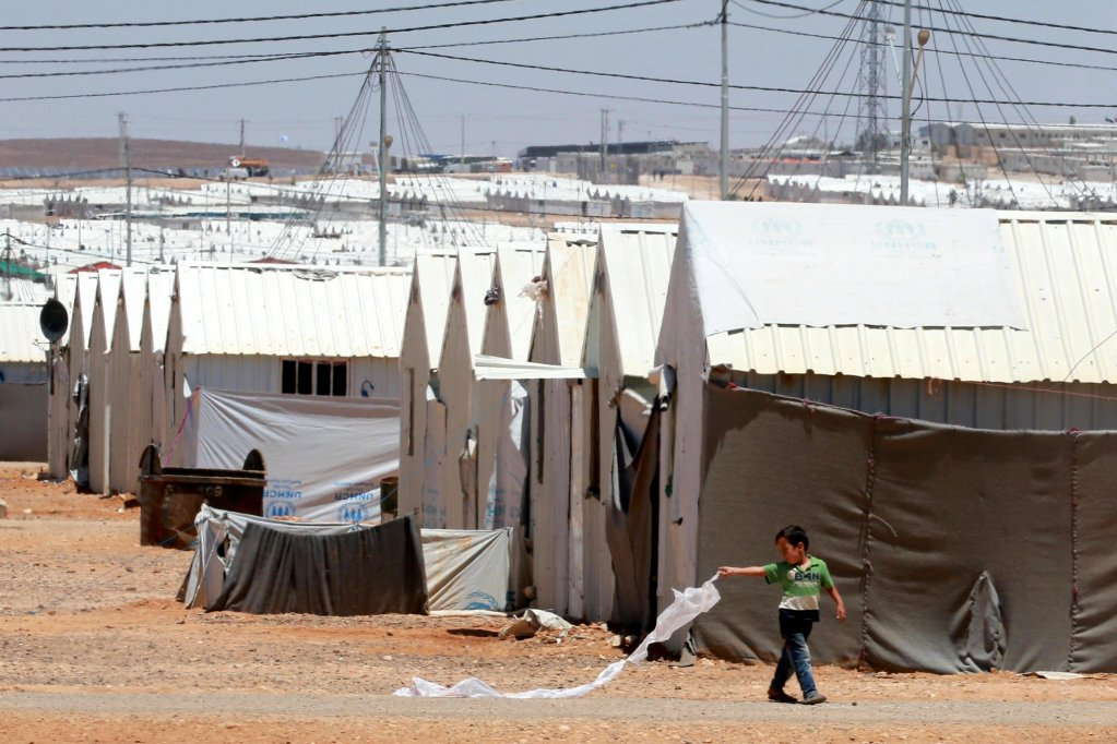 Syrian refugee playing with a home-made kite at the Azraq refugee camp, near Zarqa, some 100 km from Amman, Jordan. PHOTO/ARCHIVE/EPA/AMEL PAIN