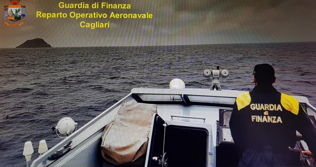 A coast guard cutter in Cagliari searching for eight migrants who have been missing since a shipwreck four days ago off Sant'Antioco, in south-west Sardinia | Credit: Tax police
