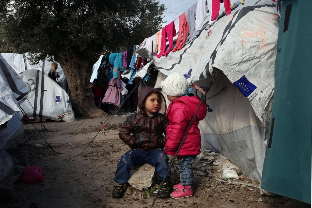 Children talk outside their tent at the Moria refugee camp on the Greek island of Lesbos on January 8, 2020 | Photo: EPA/Orestis Panagiotou