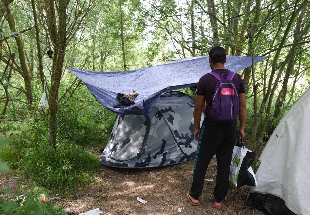 Un migrant afghan dans un campement à Calais.  Credit: Mehdi Chebil