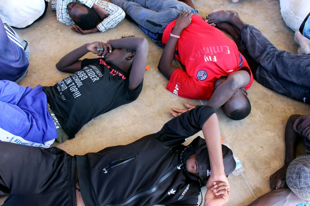 Migrants lay exhausted on the floor after being rescued from a shipwreck: Photo : Reuters file picture