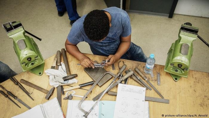 "A refugee taking up apprenticeship training, or ""Ausbildung"" in Germany"