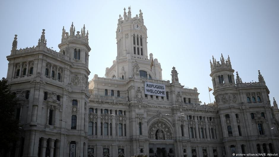A banner on Madrid's city hall encapsulates Spain's overall approach to immigration