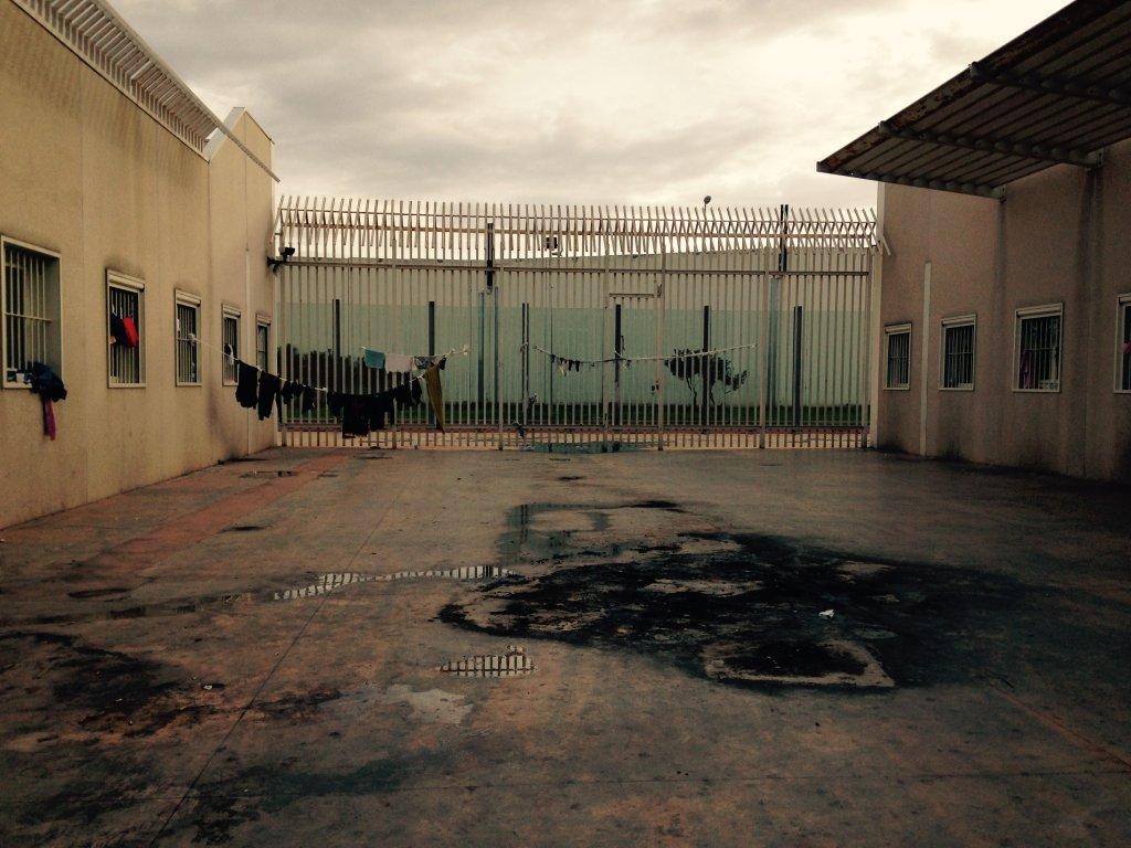 Courtyard of the Bari CIE with burn marks on the ground, 12 November 2014 | Photo: Donatella Lopez / ANSA