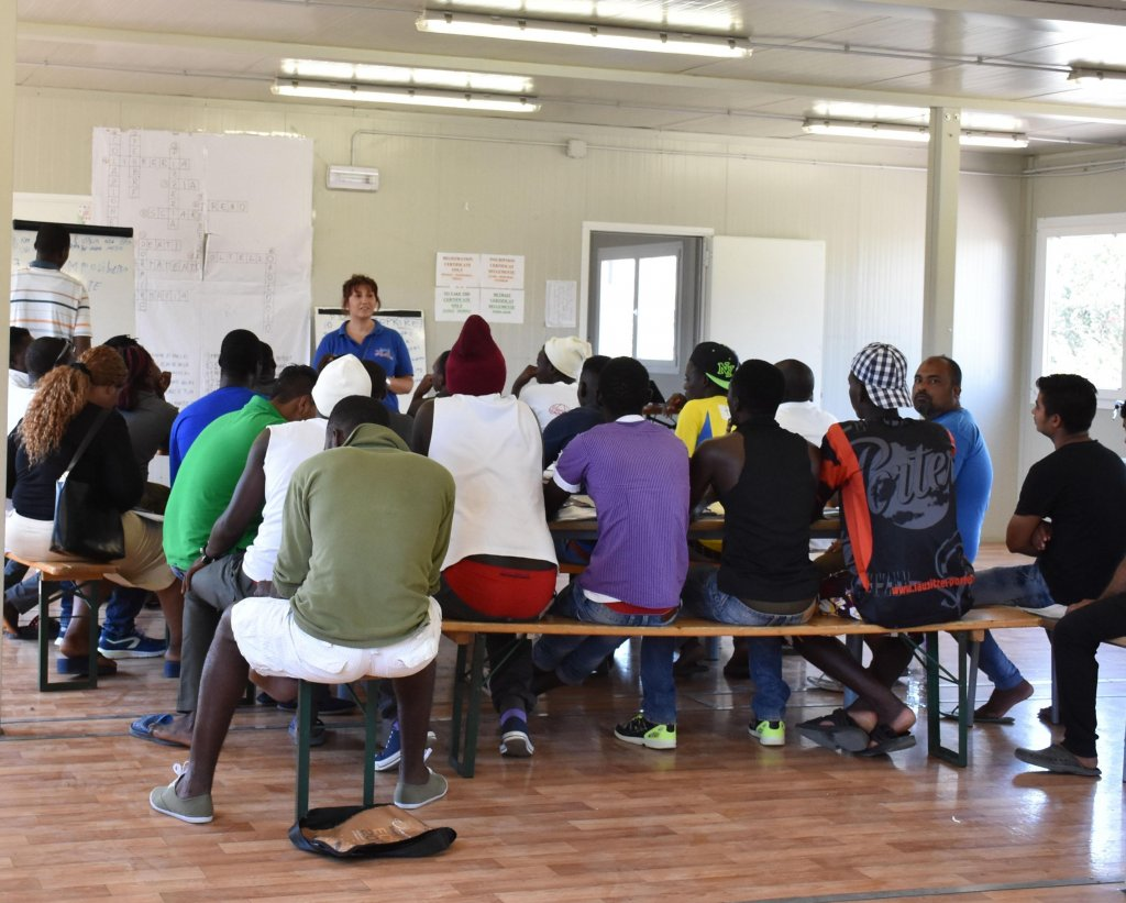 Migrants attend a lesson at the hosting center for asylum seekers in Mineo (Catania). CREDIT:ANSA/ORIETTA SCARDINO