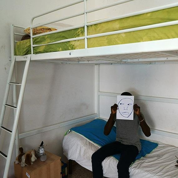 A young migrant in his bedroom | Photo: Archive ANSA/ Oxfam press office