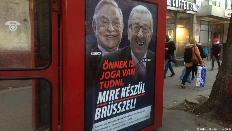 "Billboard poster showing HUngarian-American financier George Soros and EU Commission President Jean-Claude Juncker above the caption: ""You have a right to know what Burssls is preparing to do!"" in Hungary, February 19, 2019 