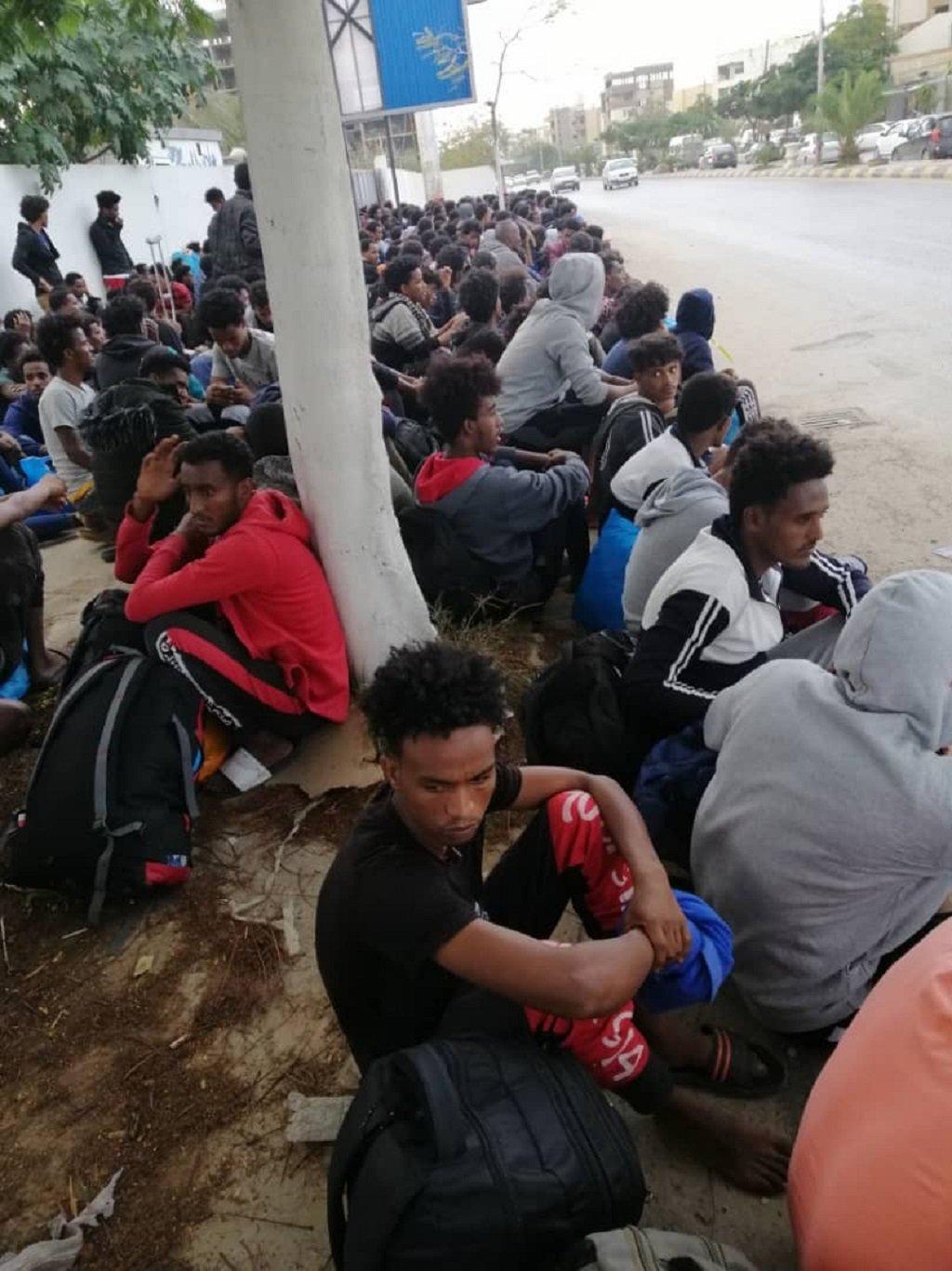 A group of migrants sit outside the UNHCR-run GDF facility in Tripoli   Photo: Abu Salim migrants