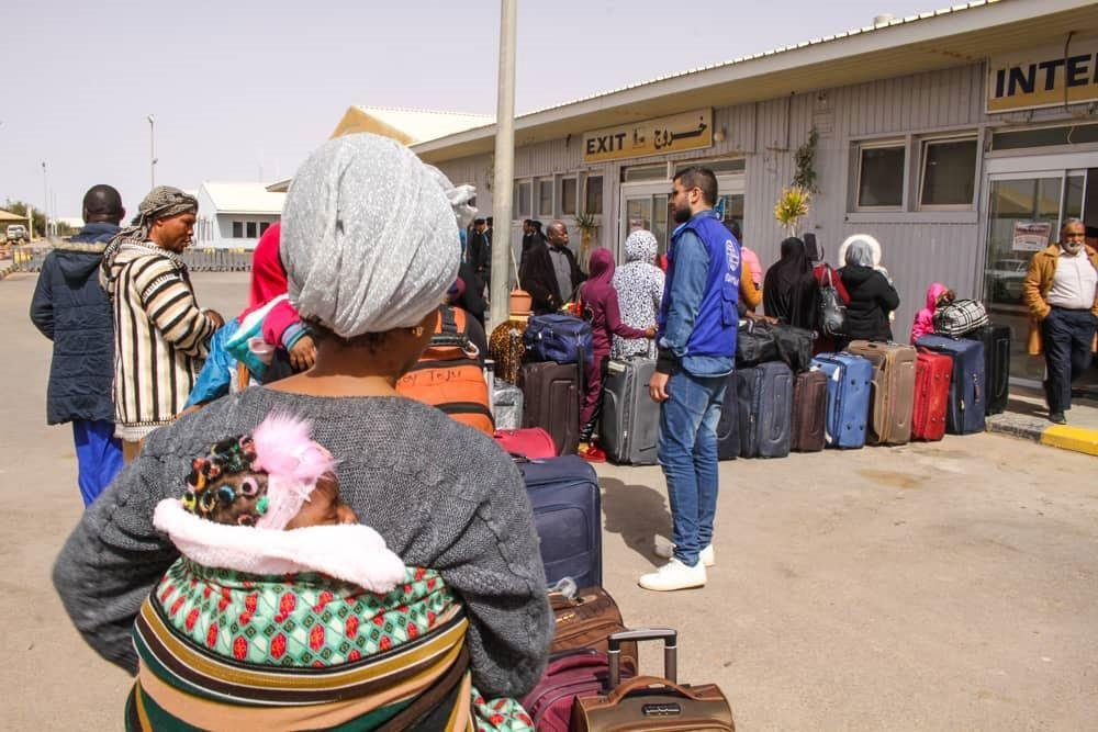 Aisha, 28, moments before returning home to Nigeria on a Voluntary Humanitarian Return flight from Libya. Credit: Mohamed Hmouzi/IOM