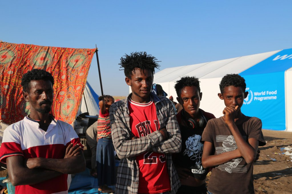 A handout photo made available by the UN World Food Programme (WFP) shows Ethiopian refugees who fled the conflict in Ethiopia's Tigray region posing for a photograph in Hamdayet Reception Center, in the border town of Hamdayet, Sudan, 17 November 2020   Photo: EPA/LENI KINZLI