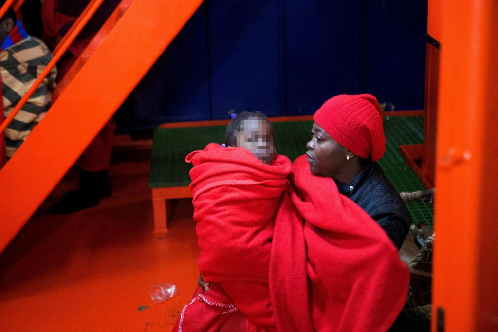 A migrant woman and her child arrive at the port of Motril, Spain, January 26 2018 Credit: EPA/Miguel Paquet