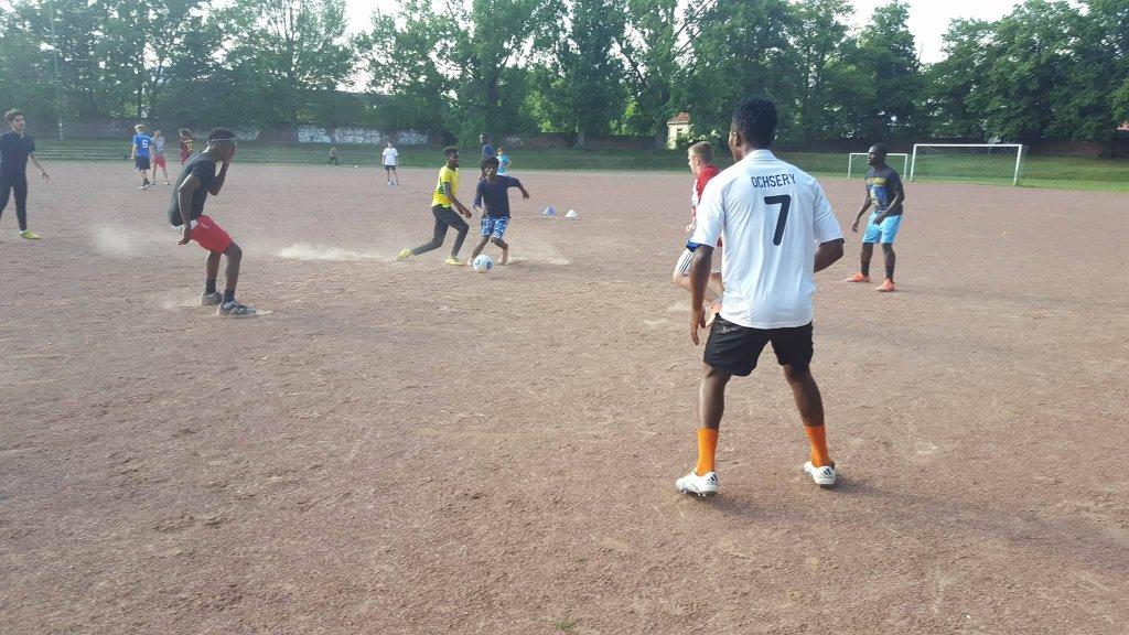 Refugees playing football near Bonn, Germany | Photo: Wesley Dockery