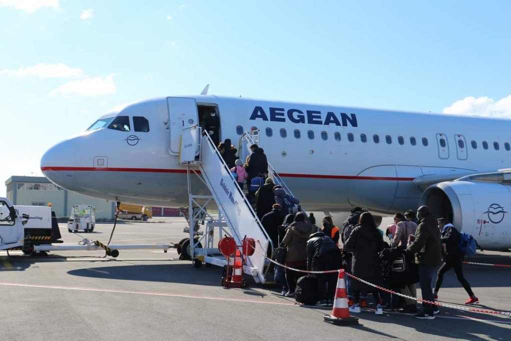 A flight from Lesbos brought 116 refugees to Hanover in Germany on Wednesday, February 17 | Source: IOM Greece Twitter feed @IOMGREECE