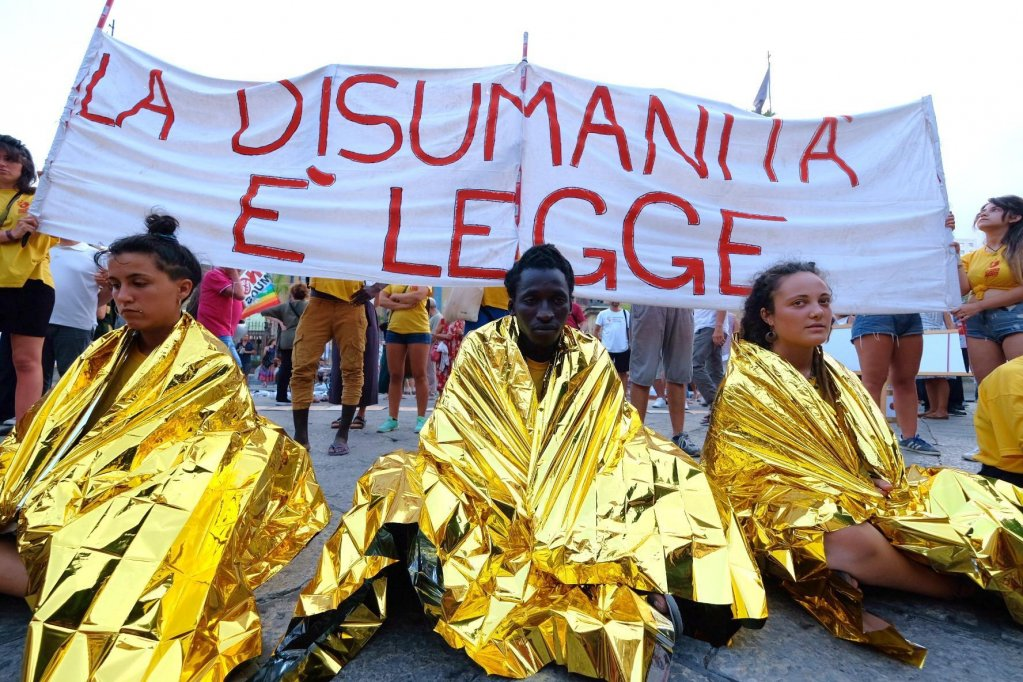 A demonstration against the security decree held on August 8 in Palermo. The banner says 'inhumanity is law' | Photo: ANSA/IGOR PETYX