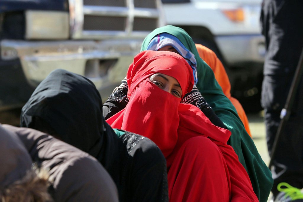 Migrants being detained by Libyan security forces   Credit: EPA/STR