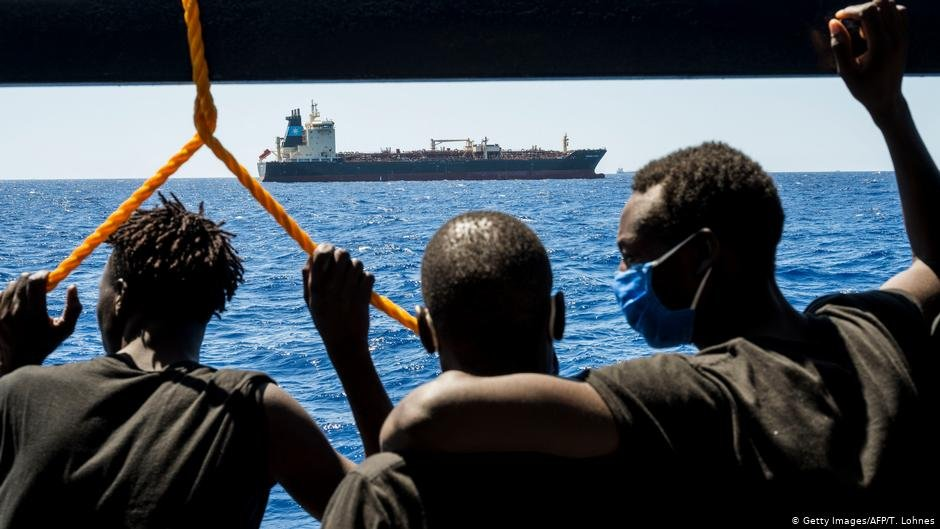 Migrants onboard the Sea-Watch 4 civil sea rescue ship observe the oil tanker Maersk Etienne   Photo: Getty Images/AFP/T.Lohnes