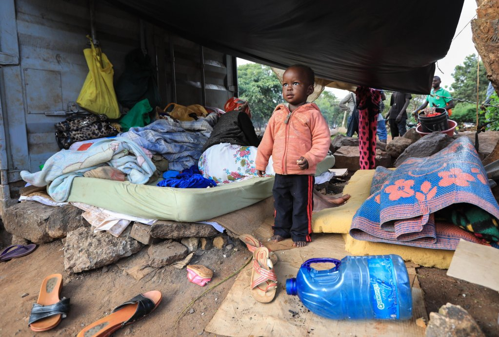 Ethiopian refugee boy in a makeshift shelter next to a highway in Nairobi, Kenya | PHOTO: EPA/DANIEL IRUNGU