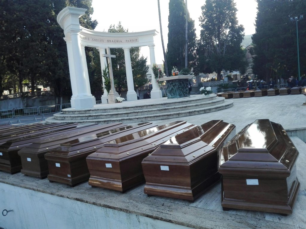 Coffins of 26 migrants who drowned in the Mediterranean before their funeral in Salerno, Italy, in November 2017 | Photo: ANSA