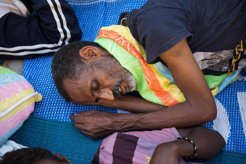 Migrants seen at Njila detention center after they fled from another center near the airport due to fighting between rival factions in Tripoli, Libya | Credit: EPA/STR