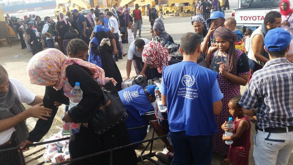 The photo shows IOM staff assisting some of the Ethiopian migrants prior to departure from Yemen. Credit: IOM
