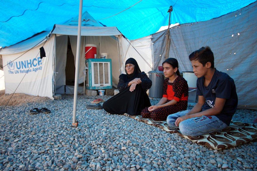 © رويترز |لاجئون في مخيم في العراق