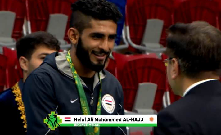 Helal Al-Hajj accepts a bronze medal in the 4th Islamic Solidarity Games in Baku, May 2017 | Source: Screenshot YouTube