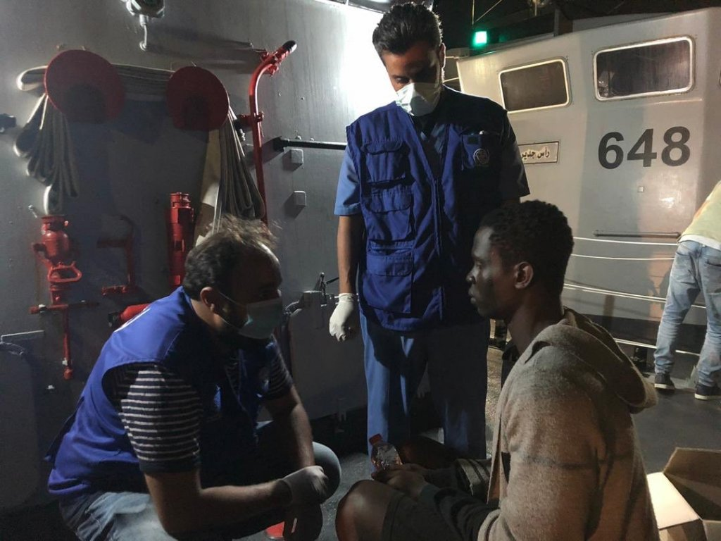 IOM staff attending to a migrant who was returned to Tripoli by Libyan coast guards | Source: Twitter/IOM Libya (June 25, 2020)