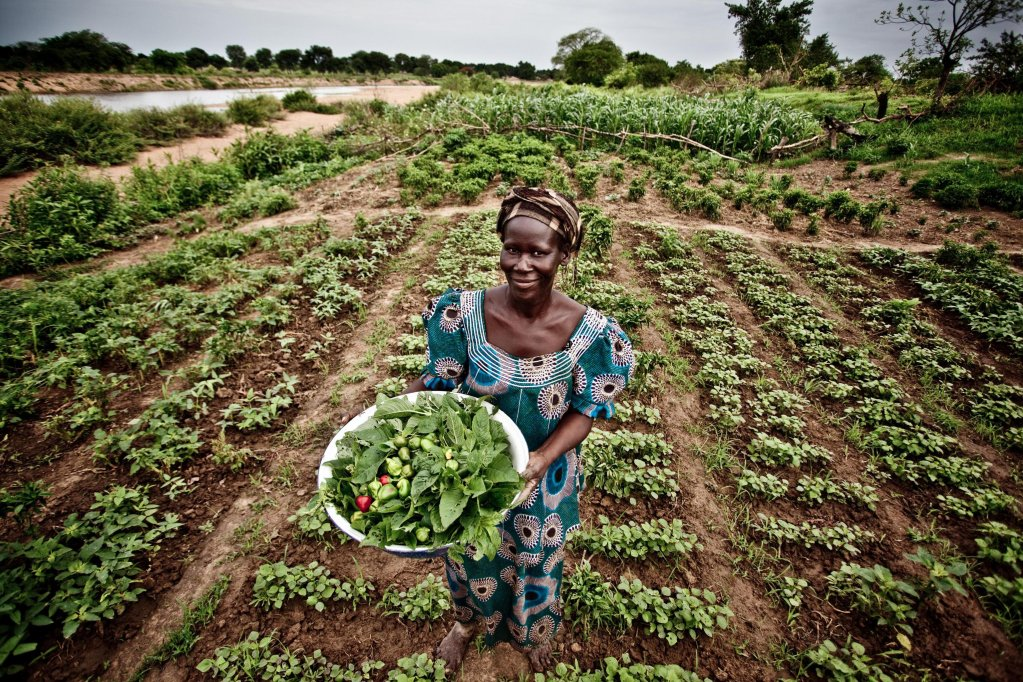 A woman working in a field in Italy | Photo: ANSA/Oxfam