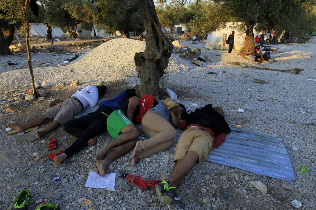Refugees from Syria sleeping in a makeshift camp outside the city of Mytilini on Lesbos island in the north Aegean. PHOTO/ARCHIVE/EPA/ORESTIS PANAGIOTOU