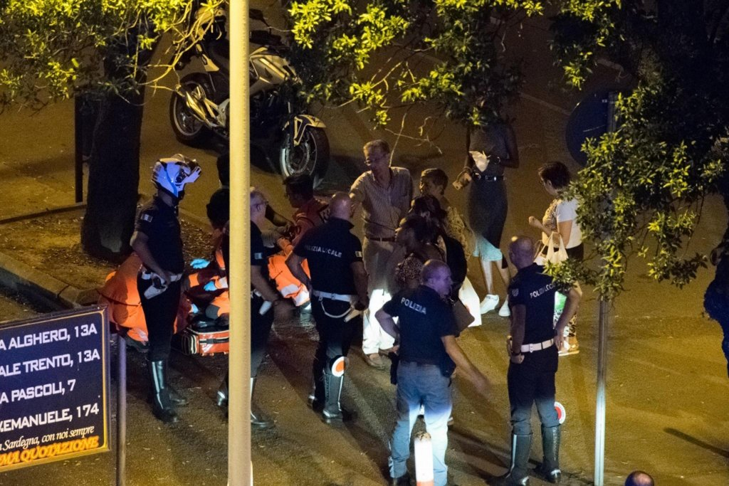 Picture shows police officers in the place where a young migrant from Guinea was beaten to death by a herd of at least five boys in Sassari. PHOTO/ANSA/GIAN MARIO SIAS