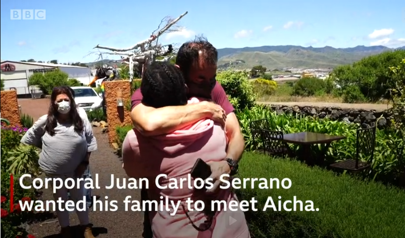A screenshot from the BBC video when Aicha and Juan Carlos Serrano reunited after he rescued her | Source: BBC Video