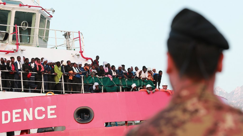 Carlo Hermann, AFP file picture | Migrants rescued from the sea stand on the deck of the Italian rescue ship Vos Prudence as it arrives in the port of Salerno July 14, 2017