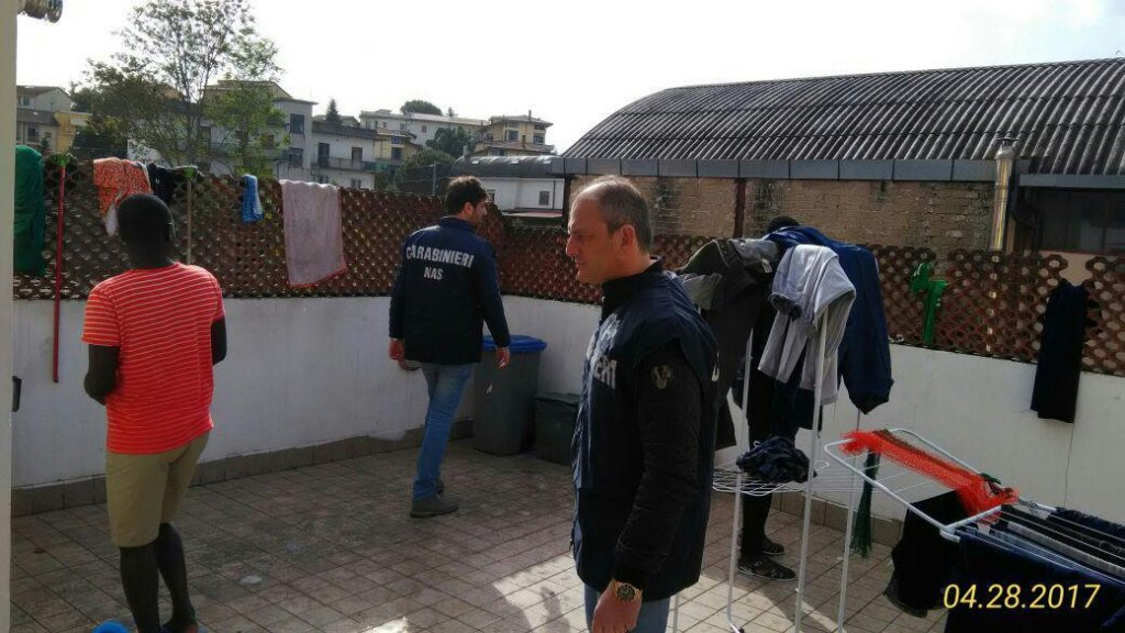 Police in a migrants' center in a migrants' center in Benevento, Italy