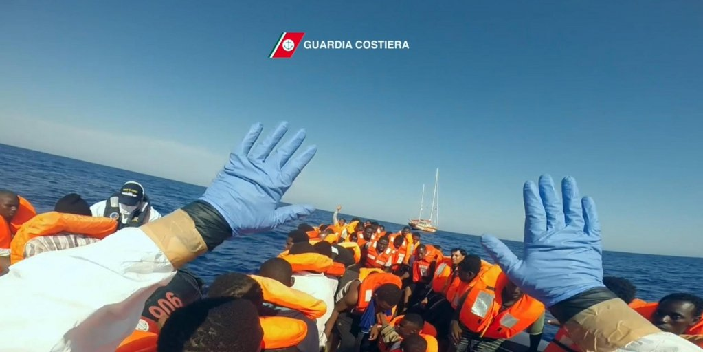 Migrants on a boat during a rescue operation conducted by the Italian coastguard in the Mediterranean Sea. Photo: Italian Coastguard