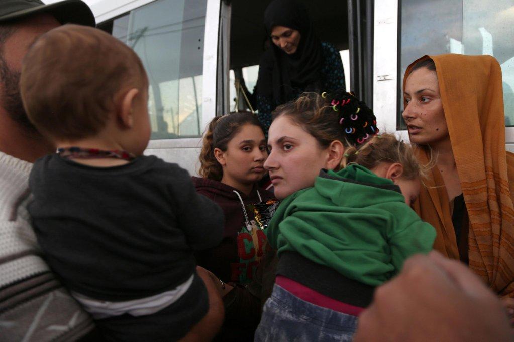 ANSA / مجموعة سوريين لدى وصولهم لمخيم بارداراش للاجئين، جنوب مدينة دهوك بإقليم كردستان العراق. المصدر: إي بي إيه / جيلان.