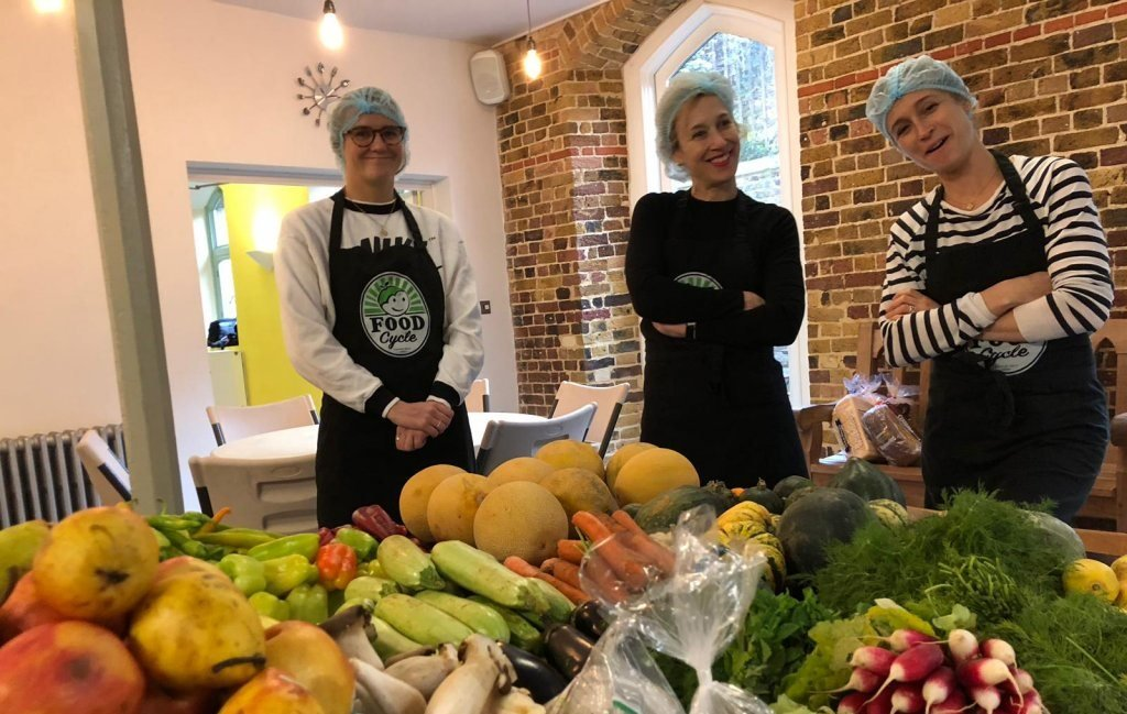 Some members of the FoodCycle team pose with some of the fresh produce which goes into their meals | Photo: With kind permission of FoodCycle