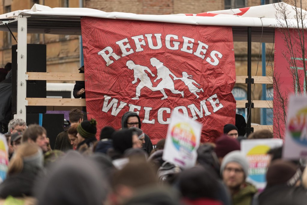 A banner reading 'Refugees Welcome' at a demonstration against the convention of the German right-wing 'Alternative for Germany' party (AfD), Riesa, Germany, 12 January 2019.EPA/MARKUS HEINE