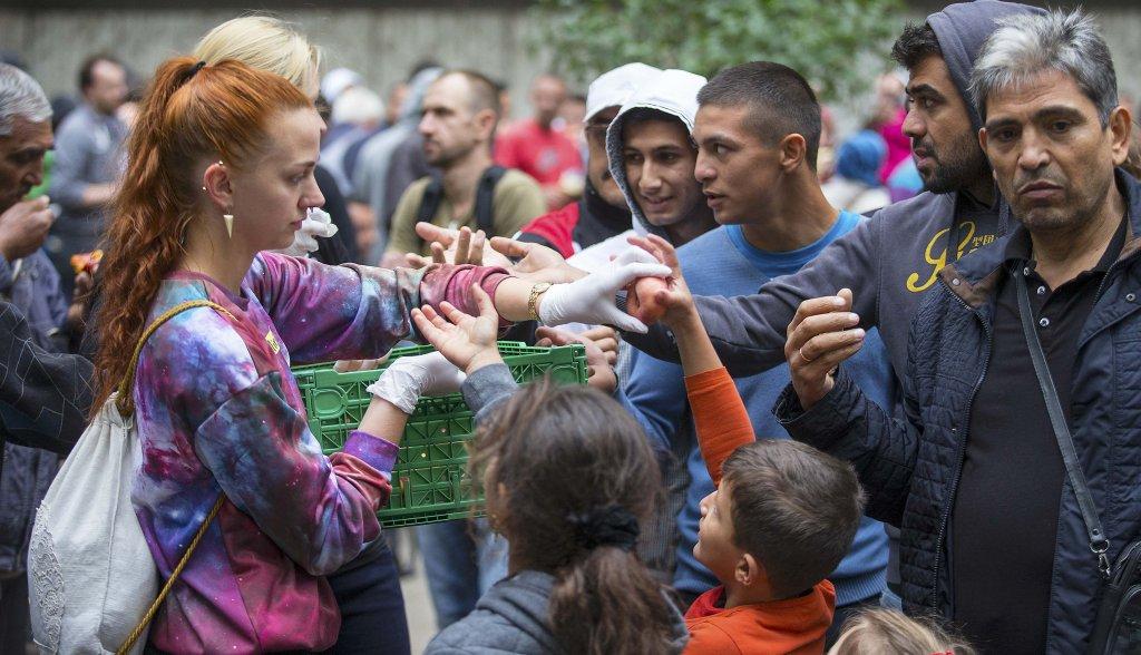 REUTERS/Hannibal Hanschke |Distribution de nourriture aux migrants arrivés en Allemagne en 2015. (Photo d'illustration)