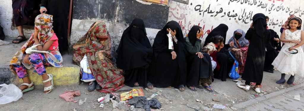 Yemeni children and women waiting to receive their families' free food rations from a local charity in Sana'a | Credit: EPA/YAHYA ARHAB