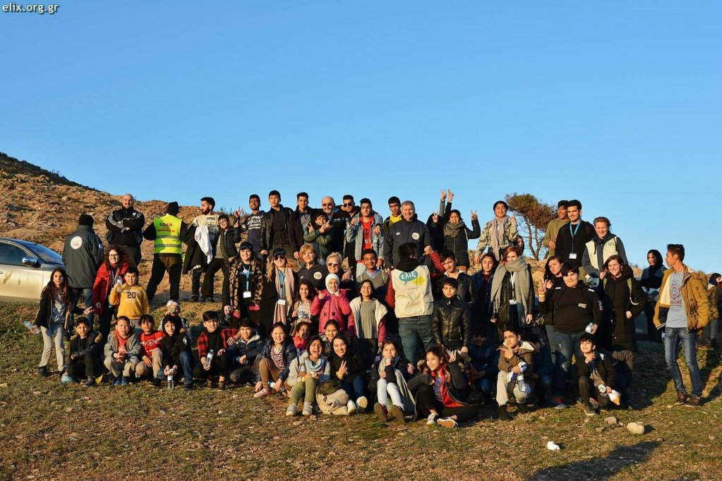 The 80 children pose for a group shot before starting their tree-planting on Mount Pentelis. CREDIT: ELIX