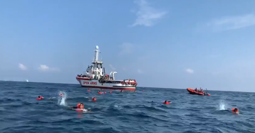 Migrants swimming towards Sicily after jumping off the Open Arms rescue vessel on Thursday 17 September | Screenshot from Tweet from Open Arms