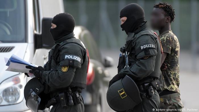 Pilce in Ellwangen, Germany at a raid at an asylum center