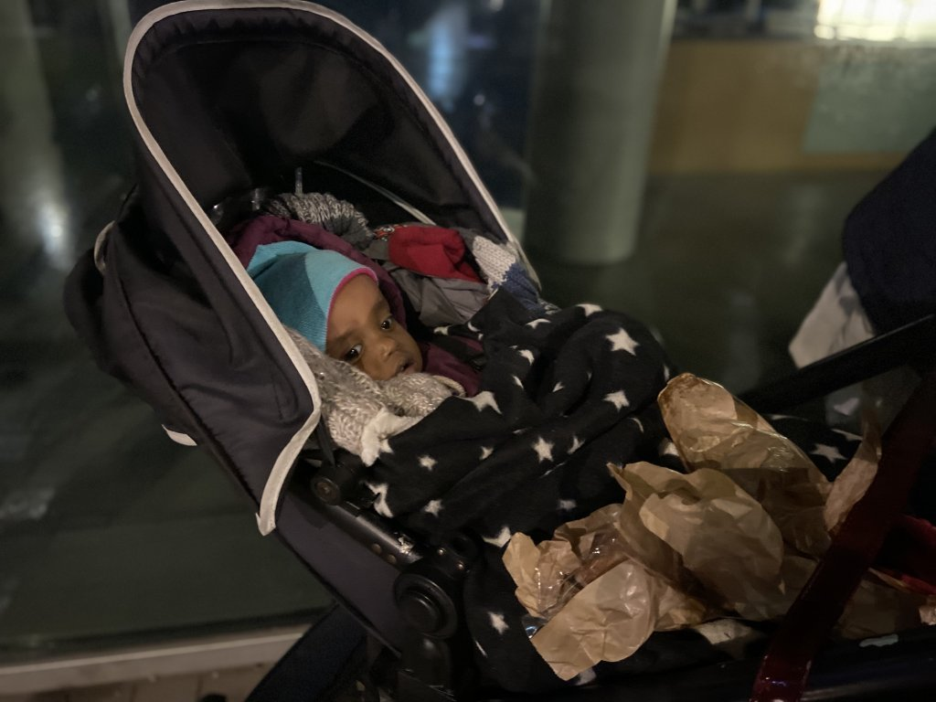 One-year-old Said lies in his stroller in northern Paris. His parents are desperate for a place for the family to stay tonight | Photo: InfoMigrants